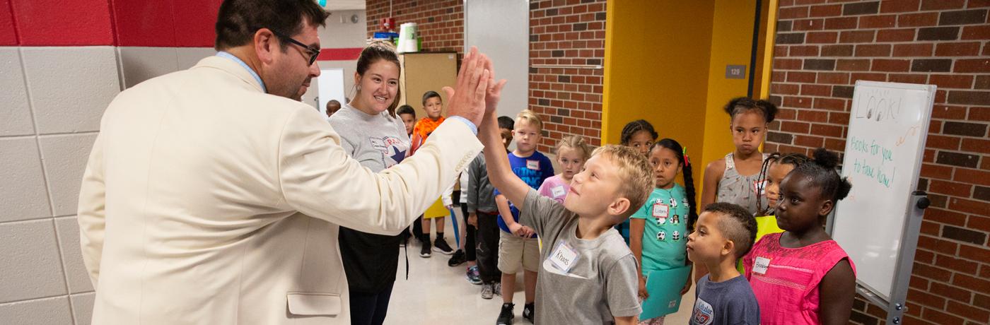 Oak Park Elementary School Students Giving High Five
